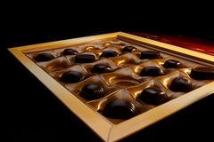 Chocolate candy. new Year. gift. Chocolate candy in a box. on a black background. macro shooting. flash. new Year. gift Stock Photos