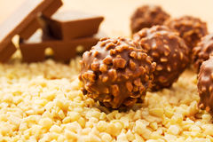 Chocolate candy with nuts. Chocolate candy balls with chopped nuts and chocolate bars Royalty Free Stock Photos