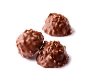 Chocolate candy with nuts close-up on white Royalty Free Stock Photo