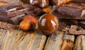 Chocolate candy   and nuts  on   wooden table Stock Images