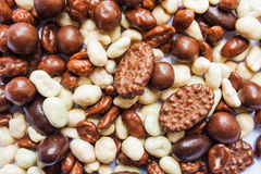 Chocolate candy pile, white and milk chocolate and caramel Royalty Free Stock Image