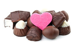 Chocolate candy and pink heart Royalty Free Stock Photos