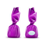 Chocolate Candy in Purpule Wrapper on Background Stock Image