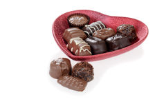 Chocolate candy in red heart bowl Stock Photography
