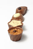 Chocolate candy in a row. Different kinds of chocolate candy Stock Photography