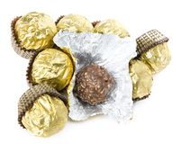 Chocolate candy scattering. In the gold cover on the white background Stock Photo