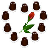 Chocolate candy in the shape of a heart with a rose inside. Royalty Free Stock Photo