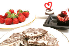 Chocolate candy and strawberry. Isolated photo of chocolate candy and strawberrys on top on white Royalty Free Stock Photos