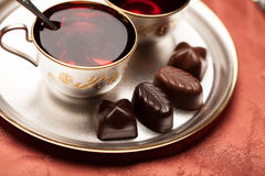Chocolate candy, tea Stock Photography