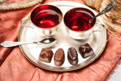 Chocolate candy, tea Stock Image