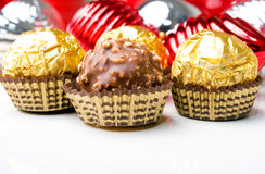 Chocolate candy treats Christmas New Year holiday. Chocolate candy treats with Christmas New Year holiday theme ornaments Stock Photography