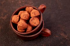 Chocolate Candy truffles in brown plate. Copy space, Dessert. Cocoa candies. delicious. tasty royalty free stock photo