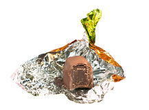 Chocolate candy unwrapped in golden foil royalty free stock image