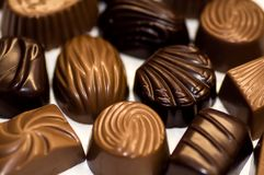 Chocolate candy of various shapes with different fillings. Chocolate candy of various shapes with different fillings stock photos
