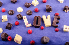 Chocolate candy white and black, heart, figures Royalty Free Stock Photo