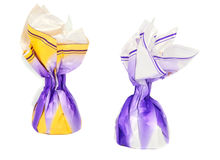 Chocolate candy in a wrapper. On a white background Royalty Free Stock Images