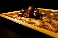 Chocolate candys. Chocolate candy in a box. on a black background. macro shooting. flash. new Year. gift Stock Photo