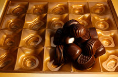 Chocolate candys. Chocolate candy in a box. on a black background. macro shooting. flash. new Year. gift Stock Image