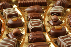 Chocolate candys with icing in golden box Royalty Free Stock Photo