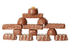 Chocolate candys with icing pyramid figure Royalty Free Stock Image