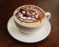 Chocolate cappuccino time.Cup of coffee Stock Photography