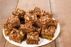 Chocolate caramel brownies with nuts Royalty Free Stock Photos