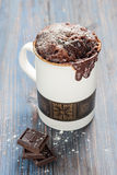 Chocolate caramel cake in a mug Stock Photos