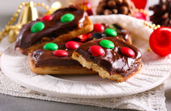 Chocolate and caramel candy decorated Christmas cookies Royalty Free Stock Image