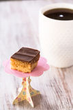 Chocolate Caramel Cookie Candy With Cup Of Coffee Royalty Free Stock Images