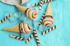 Chocolate and caramel ice cream creamy spirals in waffle cones Stock Photo