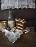 Chocolate and caramel layer cake. Piece of Chocolate and caramel cake in a dark country style rustic setting. Layers of chocolate cake, chocolate mousse and stock photo