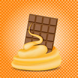 Chocolate and caramel mixed stream, orange background. Stock Photo