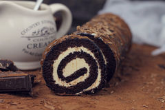 Chocolate and caramel roll cake Royalty Free Stock Photography
