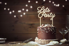 Chocolate celebration cake. In a party setting Royalty Free Stock Photos