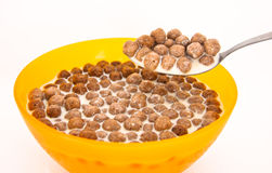 Chocolate cereal. Ball on spoon with milk royalty free stock photo