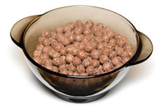 Chocolate cereal. In a glass bowl on white background royalty free stock images