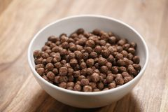 Chocolate cereal balls in white bowl for breakfast Stock Photography