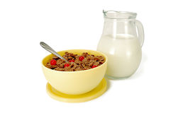Chocolate cereal with berries and milk jug Royalty Free Stock Image