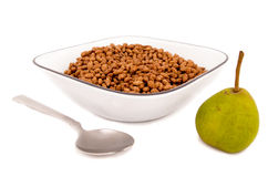 Chocolate cereal breakfast on a bowl with a pear Royalty Free Stock Photography