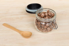 Chocolate cereal cornflakes in the glass jar Stock Image
