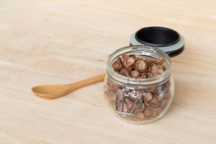 Chocolate cereal cornflakes in the glass jar Royalty Free Stock Images