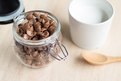 Chocolate cereal cornflakes and milk for breafast Stock Photos