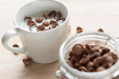 Chocolate cereal cornflakes and milk for breafast Stock Photo