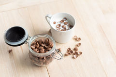 Chocolate cereal cornflakes and milk for breafast Stock Images