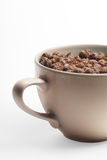 Chocolate cereal in cup. Closeup of chocolate cereal in a cup or bowl Royalty Free Stock Photos