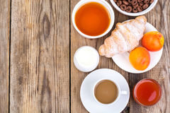 Chocolate cereal flakes, coffee, milk, croissant and fruit for b stock photography