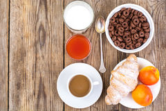 Chocolate cereal flakes, coffee, milk, croissant and fruit for b stock photo