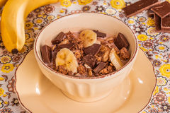 Chocolate cereal with milk, banana and chocolate chips Royalty Free Stock Images