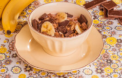 Chocolate cereal with milk, banana and chocolate chips Stock Image