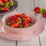 Chocolate cereal with milk and strawberries Royalty Free Stock Images